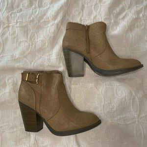 Brown booties with gold buckle